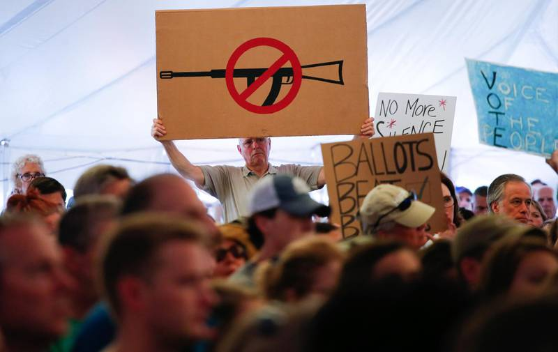 A man displays an anti gun violence sign during a March for our Lives Rally at Fairfield Hills Campus, in Newtown Connecticut on August 11, 2018. (Photo by KENA BETANCUR / AFP)