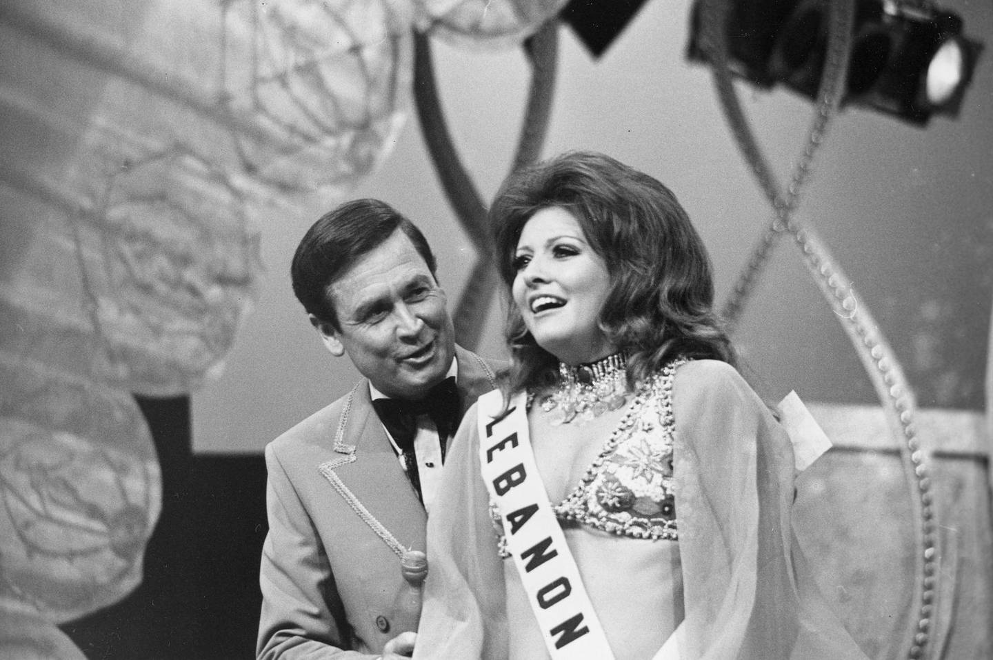 Georgina Rizk, from Beirut, Lebanon, reacts after being named Miss Universe as pageant host Bob Barker talks to her at the Miami Beach Auditorium, Fla., July 24, 1971.  (AP Photo)