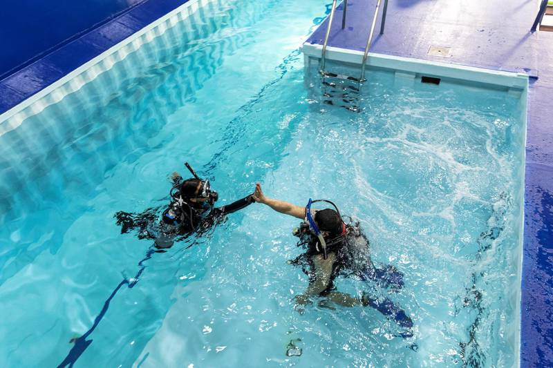 DUBAI, UNITED ARAB EMIRATES. 07 MARCH 2021. Michela Colella, Dive Instructor, conducts a training session with a learner diver in the newly opened indoor pool at the Dive Garage facility in Al Quoz 4. The pool is constructed out of shipping containers and hols a 100 000 liters of fresh water, making it one of a kind in the Middle East. (Photo: Antonie Robertson/The National) Journalist: Janice Rodriques. Section: National.