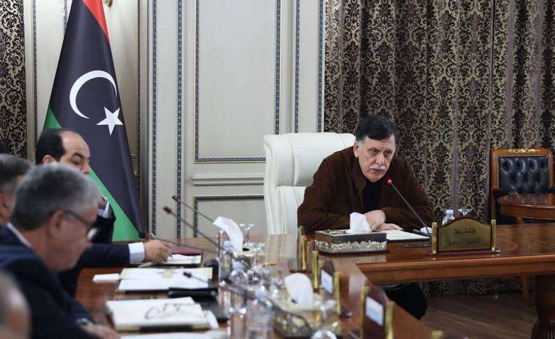 Libya's UN-recognised Prime Minister Fayez al-Sarraj holds a cabinet meeting in the Libyan capital Tripoli on December 19, 2019.  Libya's UN-recognised Government of National Accord (GNA) approved the implementation of a military deal with Turkey, paving the way for a bigger role for Ankara in the conflict-hit country. The GNA, which met in the presence of military officials, gave no further details about the terms of the agreement or the assistance Ankara could provide to pro-GNA forces facing an offensive by east Libyan military strongman Khalifa Haftar. / AFP / -