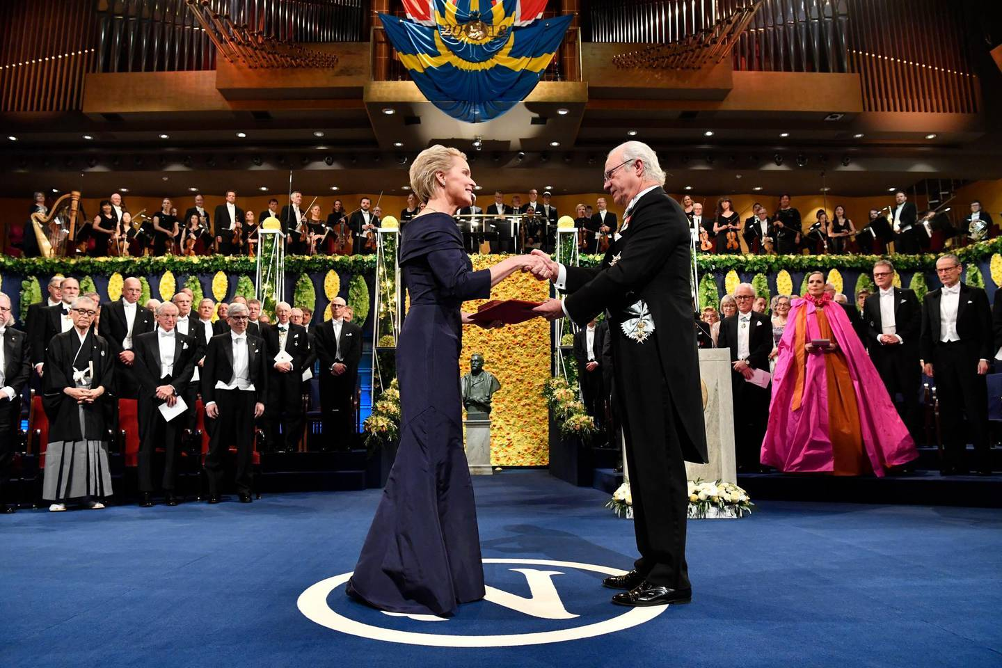 """FILE - In this Dec. 10, 2018, file photo, Chemistry laureate Frances H. Arnold, left, receives the prize from King Carl Gustaf of Sweden, during the Nobel Prize award ceremony, at the Stockholm Concert Hall, in Stockholm. The Nobels, with new winners announced starting Monday, Oct. 5, 2020, often concentrate on unheralded, methodical, basic science. """"Without basic science, you won't have cutting-edge applied science,"""" said Frances Arnold, a Caltech chemical engineer who won the 2018 Nobel in chemistry. (Pontus Lundahl/Pool Photo via AP, File)"""