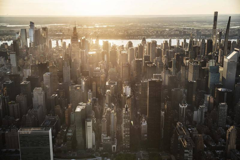 Buildings in the Manhattan skyline in New York, U.S., on Thursday June 17, 2021. New York state's pandemic mandates were lifted last week, after 70% of the adult population has now been given at least one dose of a coronavirus vaccine. Photographer: Victor J. Blue/Bloomberg