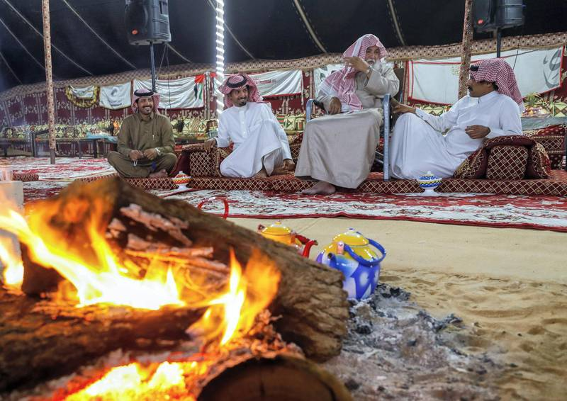 Abu Dhabi, United Arab Emirates, December 10, 2019.    --Men of the Dawasir tribe from Saudi Arabia relax after a victory at the Al Dhafra Festival in Abu Dhabi, UAE.Victor Besa/The NationalSection:  NAReporter:  Anna Zacharias