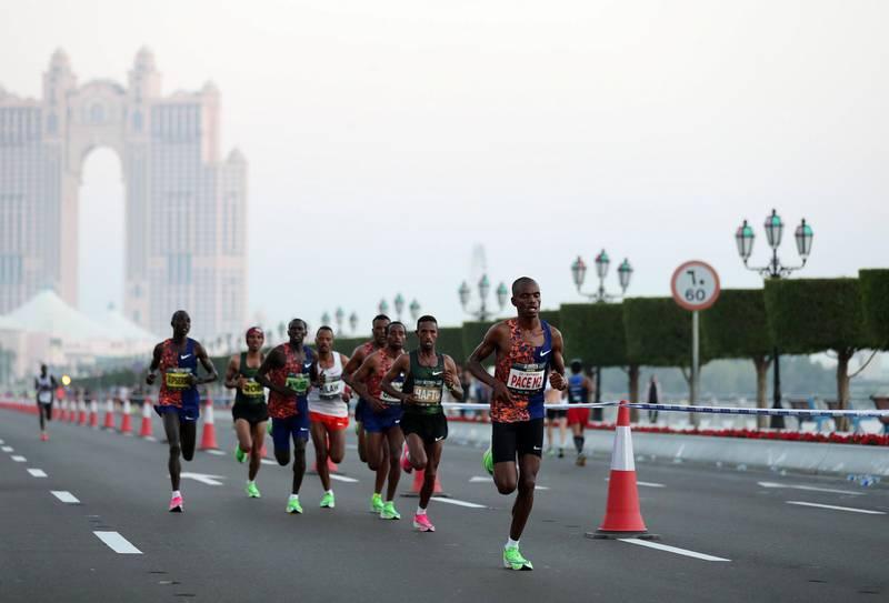 Abu Dhabi, United Arab Emirates - December 06, 2019: Reuben Kipyego in the lead in the ADNOC Abu Dhabi marathon 2019. Friday, December 6th, 2019. Abu Dhabi. Chris Whiteoak / The National