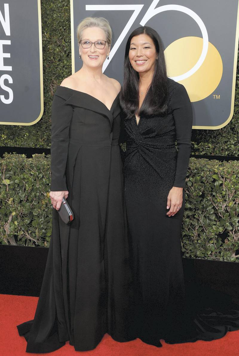 BEVERLY HILLS, CA - JANUARY 07:  Meryl Streep (L) and Ai-jen Poo attends The 75th Annual Golden Globe Awards at The Beverly Hilton Hotel on January 7, 2018 in Beverly Hills, California.  (Photo by Frederick M. Brown/Getty Images)