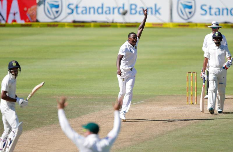 South African bowler Kagiso Rabada (2nd from R) celebrates the dismissal of Indian batsman Hardik Pandya (L) during the second day of the first Test cricket match between South Africa and India at Newlands cricket ground on January 6, 2018 in Cape Town.  / AFP PHOTO / GIANLUIGI GUERCIA