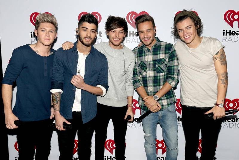 """BURBANK, CA - NOVEMBER 22:  (L-R) Musicians Niall Horan, Zayn Malik, Louis Tomlinson, Liam Payne, and Harry Styles of the band One Direction during the """"One Direction iHeartRadio Album Release Party"""" hosted by Ryan Seacrest at the iHeartRadio Theater Los Angeles – Clear Channel's new music and events venue located at The Burbank Studios in Burbank, CA  (Photo by Christopher Polk/Getty Images for Clear Channel)"""