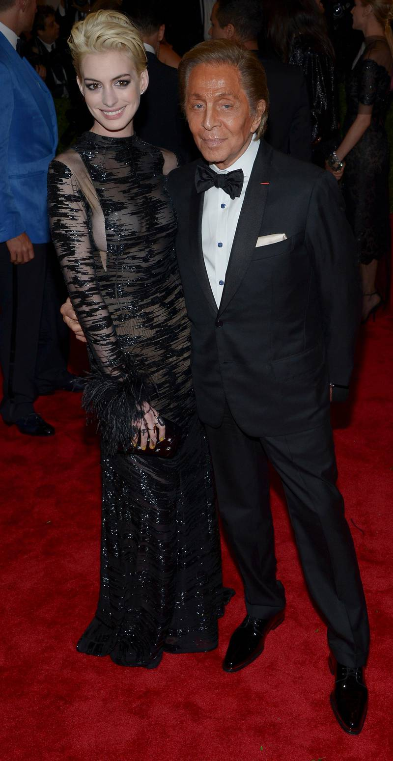 epa03690044 US actress Anne Hathaway and Italian Fashion Designer Valentino attend the Costume Institute Gala Benefit celebrating, 'Punk: Chaos to Couture,' an exhibition at the Metropolitan Museum of Art in New York, New York, USA, 06 May 2013.  EPA/JUSTIN LANE