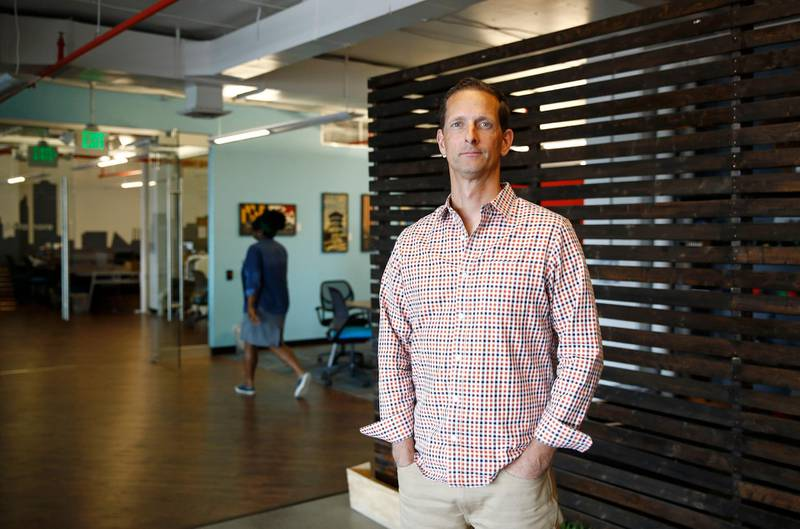 In this May 8, 2018 photo, Justin Shelby, CEO of Artichoke, a company that sells an app to help business owners manage their companies, poses for a photograph in Baltimore. (AP Photo/Patrick Semansky)