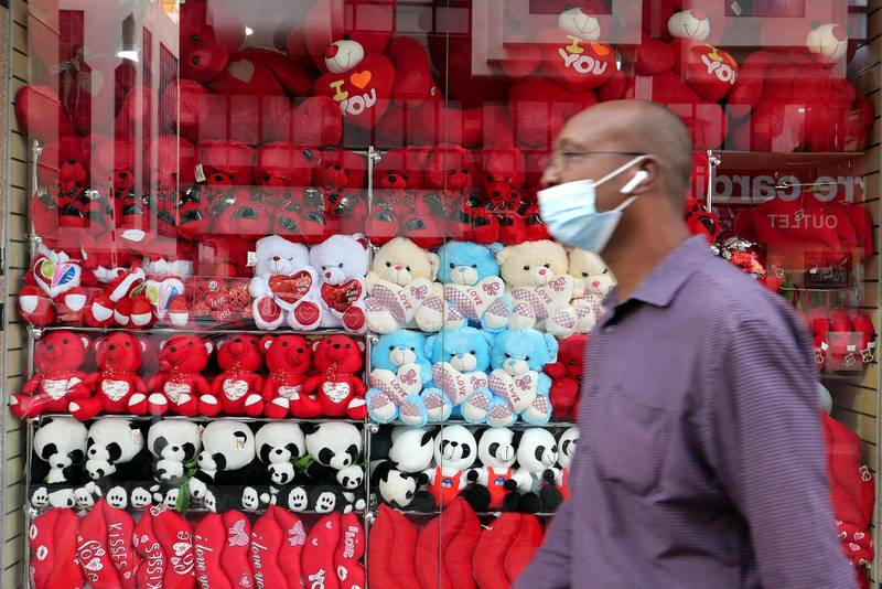 DUBAI, UNITED ARAB EMIRATES , Mar 2– 2021 :- People wearing protective face mask in Deira Dubai. UAE government told residents to wear face mask all the times outside the home whether they are showing symptoms of Covid-19 or not.  (Pawan Singh / The National) For News/Online