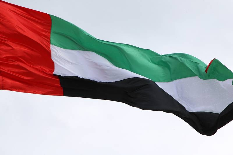 ABU DHABI , UNITED ARAB EMIRATES Ð Dec 1 , 2014 : UAE flag at one of the construction site at the corniche in Abu Dhabi. ( Pawan Singh / The National ) For News.
