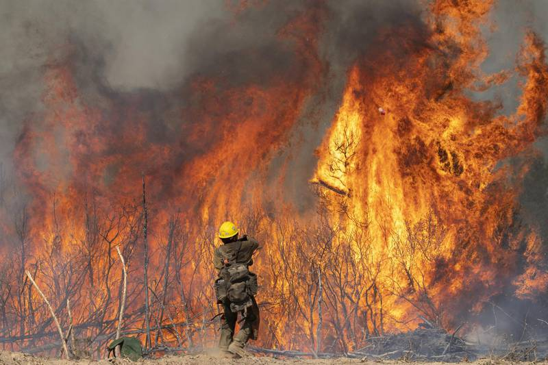 A firefighter monitors a controlled burn while fighting the Dolan Fire near Jolon, California, U.S., on Wednesday, Sept. 16, 2020. The wildfire burning in the rugged mountains of California's Big Sur coastline has burned more than 119,488 acres as of Tuesday and is 40% contained, according to the U.S. Forest Service. Photographer: Nic Coury/Bloomberg