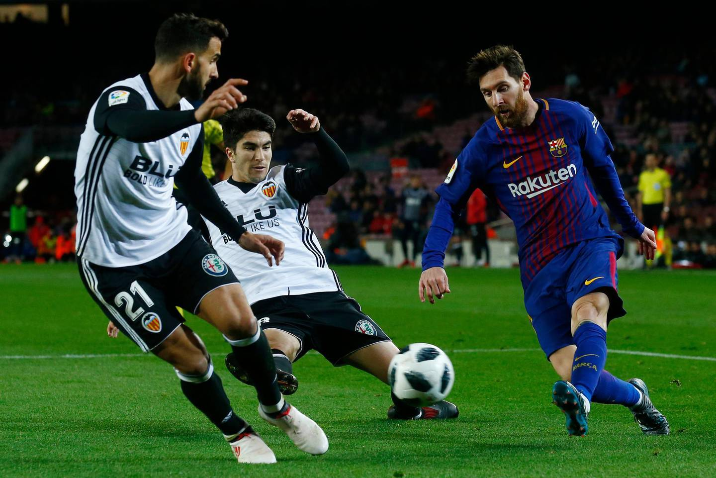 FC Barcelona's Lionel Messi, right, duels for the ball against Valencia's Carlos Soler during the Spanish Copa del Rey, semifinal, first leg, soccer match between FC Barcelona and Valencia at the Camp Nou stadium in Barcelona, Spain, Thursday, Feb. 1, 2018. (AP Photo/Manu Fernandez)