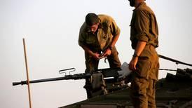 Israeli army says it hit militants placing explosives along Syrian border