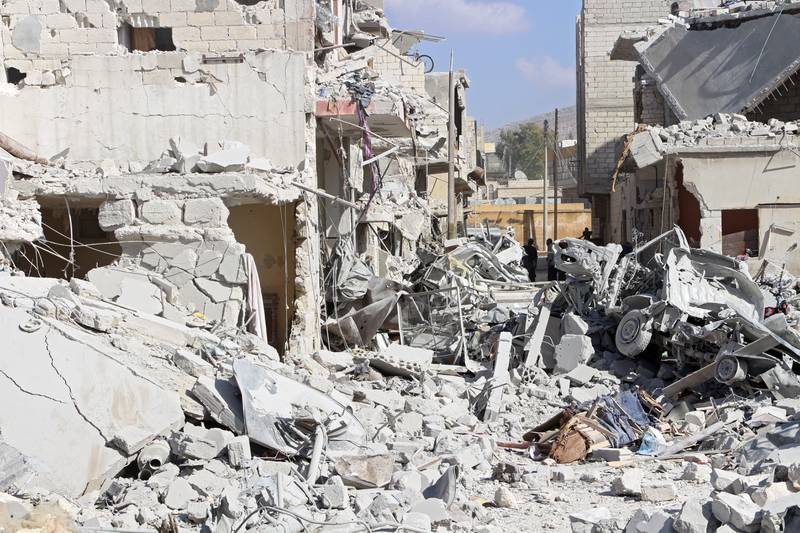 epa06236410 A general view over rubble after an airstrike in Armanaz, a rural area of Idlib Province, northern Syria, 30 September 2017. Local sources stated at least 33 people were killed in an airstrike conducted by yet undetermined forces.  EPA/STR