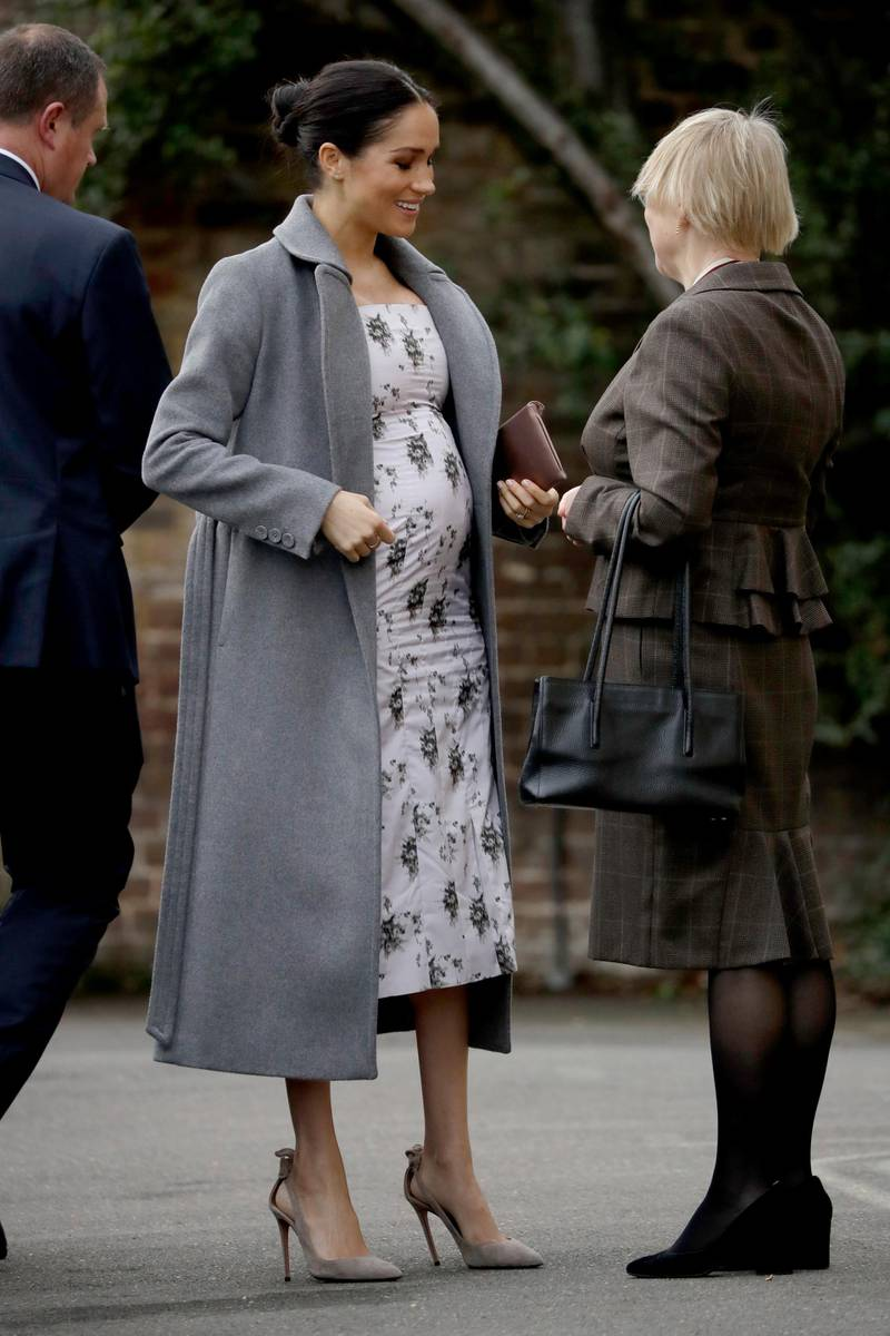 Meghan, Duchess of Sussex, arrives to visit the Royal Variety Charity's residential nursing and care home Brinsworth House, in Twickenham, south west London, Tuesday, Dec. 18, 2018. The Royal Variety Charity assists those who have worked professionally in the entertainment industry and are in need of help and assistance as a result of old age, ill-health, or hard times. (AP Photo/Matt Dunham)
