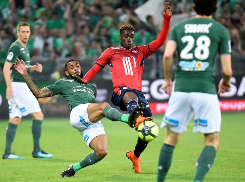 Saint-Etienne's French defender Yann M'Vila (L) vies with Lille's Malian midfielder Yves Bissouma (R) during the French L1 football match Saint-Etienne (ASSE) vs Lille (LOSC) on May 19, 2018, at the Geoffroy Guichard Stadium in Saint-Etienne, central France. / AFP PHOTO / JEAN-PHILIPPE KSIAZEK