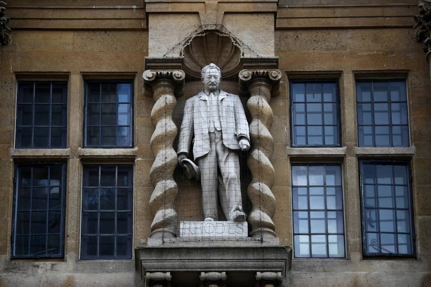 A statue of British colonialist Cecil Rhodes is seen on the side of Oriel College in Oxford, following the death of George Floyd who died in police custody in Minneapolis, Oxford, Britain, June 9, 2020. REUTERS/Hannah McKay