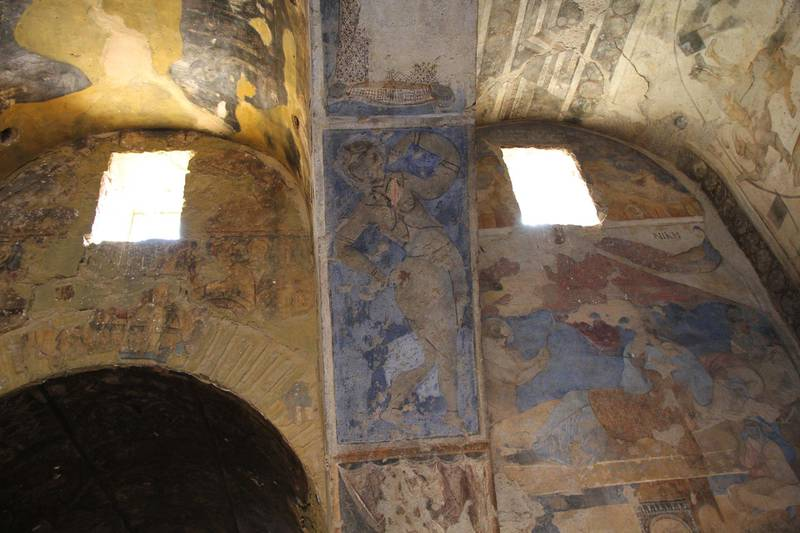 Paintings depicting daily life cover the walls of Quseir Amra. Amy McConaghy / The National