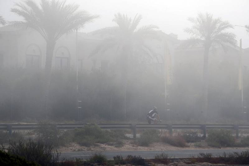 Dubai, United Arab Emirates - N/A. News. Weather. A man goes for an early morning cycle as fog covers Dubai. Monday, September 21st, 2020. Dubai. Chris Whiteoak / The National