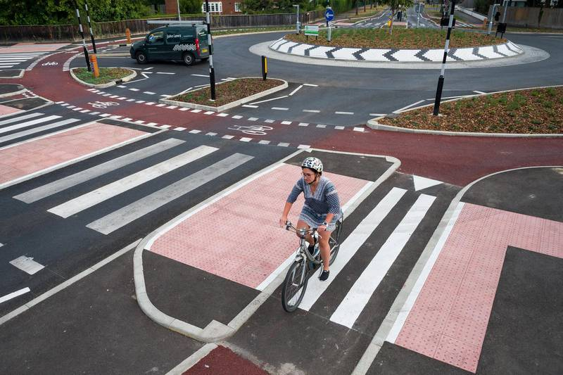 CAMBRIDGE, ENGLAND - AUGUST 10: A cyclist negotiates the new cycle-friendly roundabout on August 10, 2020 in Cambridge, England. The roundabout on Fendon Road was unveiled at the end of July and is the first of its kind in the UK. It provides an outer ring for cyclists and zebra crossings for pedestrians, requiring motorists to yield to both before entering. (Photo by Leon Neal/Getty Images)