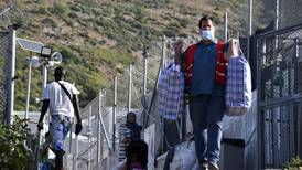 Fire forces migrants into 'prison-like' camp on Greek island of Samos