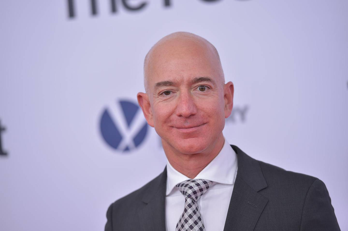 """FILES) This file photo taken on December 14, 2017 shows Amazon CEO Jeff Bezos arriving for the premiere of """"The Post"""" in Washington, DC. Triumphant in online retail, cloud computing, organic groceries, and streaming television, Amazon founder and chief disruptor Jeff Bezos is turning his seemingly limitless ambition to health care. Amazon, launched as an internet bookseller nearly 24 years ago, has branched into offerings including voice-commanded speakers infused with Alexa artificial intelligence and original TV shows streamed online at its Prime subscription service.  / AFP PHOTO / Mandel NGAN"""