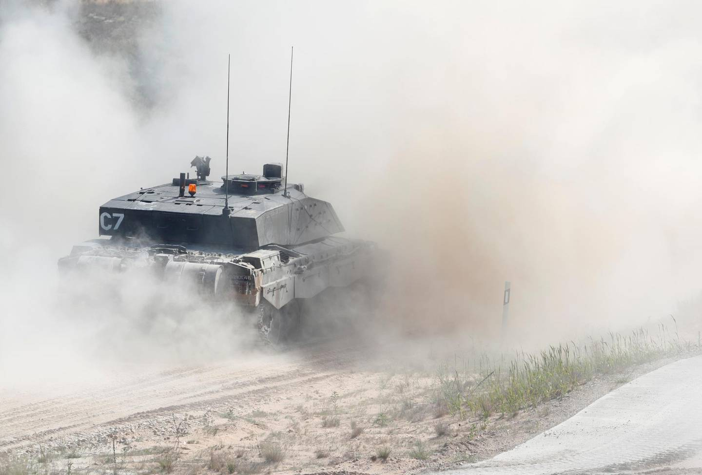 British Army Challenger tank of the NATO enhanced Forward Presence battle group based in Estonia, drives during certification field tactical exercise in Adazi, Latvia June 18, 2020. REUTERS/Ints Kalnins