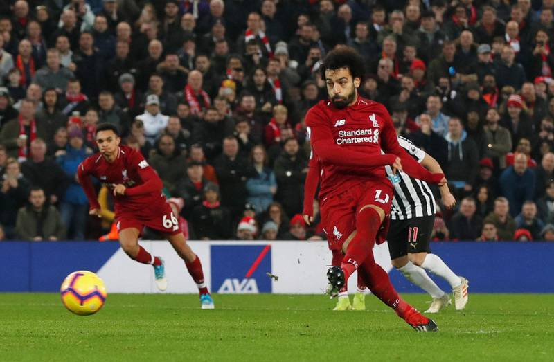 """Soccer Football - Premier League - Liverpool v Newcastle United - Anfield, Liverpool, Britain - December 26, 2018  Liverpool's Mohamed Salah scores their second goal from the penalty spot   Action Images via Reuters/Lee Smith  EDITORIAL USE ONLY. No use with unauthorized audio, video, data, fixture lists, club/league logos or """"live"""" services. Online in-match use limited to 75 images, no video emulation. No use in betting, games or single club/league/player publications.  Please contact your account representative for further details."""