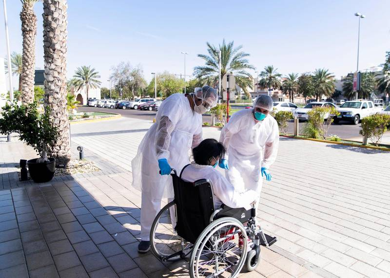 ABU DHABI, UNITED ARAB EMIRATES. MAY 2020.Heathcare workers at Sheikh Khalifa Medical City receive a patient outside the emergency department.(Photo: Reem Mohammed/The National)Reporter:Section: