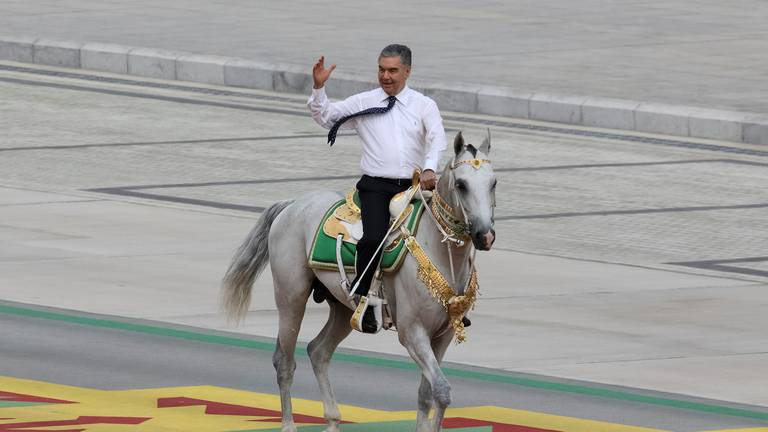 An image that illustrates this article Turkmenistan's president rides horse in colourful 30th anniversary parade