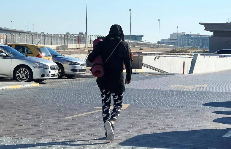 DUBAI, UNITED ARAB EMIRATES , January 5 – 2021 :- People wearing warm clothes during the winter season in Motor City area in Dubai. (Pawan Singh / The National) For News/Stock/Online.