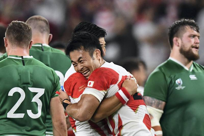Japan's players celebrate after winning the Japan 2019 Rugby World Cup Pool A match between Japan and Ireland at the Shizuoka Stadium Ecopa in Shizuoka on September 28, 2019. (Photo by Anne-Christine POUJOULAT / AFP)