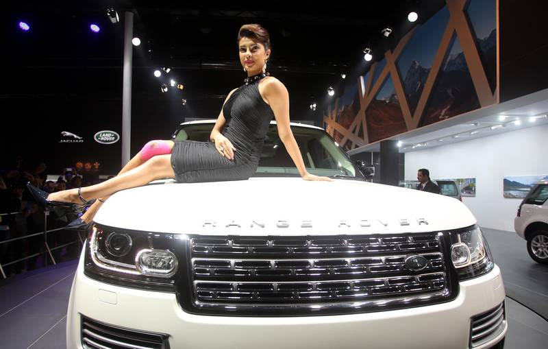 epa04055578 Bollywood actor Priyanka Chopra poses durring the launch of the Jaguar Range Rover LWD Autobiography Black at the 12th Auto Expo in Greater Noida, India, 05 February 2014. India's flagship automobile show Auto Expo starts 05 February 2014 with auto mobile companies launching new models and ends at 11 February 2014.  EPA/MONEY SHARMA