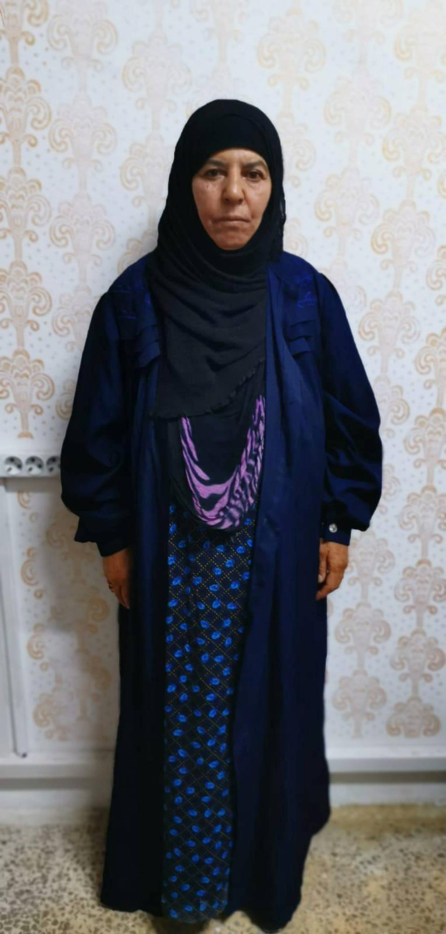 Rasmiya Awad, believed to be the sister of slain Islamic State leader Abu Bakr al-Baghdadi, who was captured on Monday in the northern Syrian town of Azaz by Turkish security officials, is seen in an unknown location in an undated picture provided by Turkish security officials. Turkish Security Officials/Handout via REUTERS ATTENTION EDITORS - THIS IMAGE HAS BEEN SUPPLIED BY A THIRD PARTY.