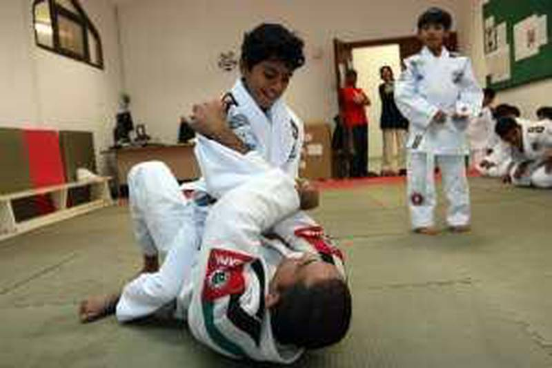 ABU DHABI. 4th Feb 2009. Rashed Daood (12) practices a hold on  instructor Marcelo Freitas during a Jiu-Jitsu class at the Zayed al Thani school in Abu Dhabi. Stephen Lock  /  The National  . FOR SATURDAY PAPER. *** Local Caption ***  SL-jitsu-002.jpgSL-jitsu-002.jpg