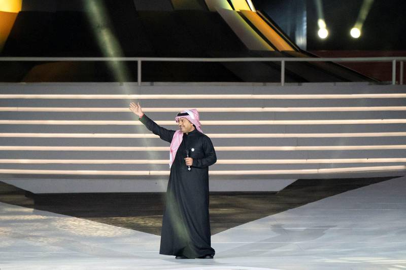 ABU DHABI, UNITED ARAB EMIRATES - March 21, 2019: Rashed Al Majed (C) sings during the closing ceremony of the Special Olympics World Games Abu Dhabi 2019, at Zayed Sports City.  ( Rashed Al Mansoori / Ministry of Presidential Affairs ) ---