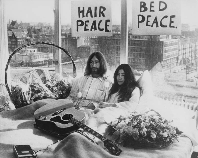 Beatle John Lennon (1940 Ôø? 1980) and his wife of a week Yoko Ono in their bed in the Presidential Suite of the Hilton Hotel, Amsterdam, 25th March 1969. The couple are staging a 'bed-in for peace' and intend to stay in bed for seven days 'as a protest against war and violence in the world'. (Photo by Keystone/Hulton Archive/Getty Images)