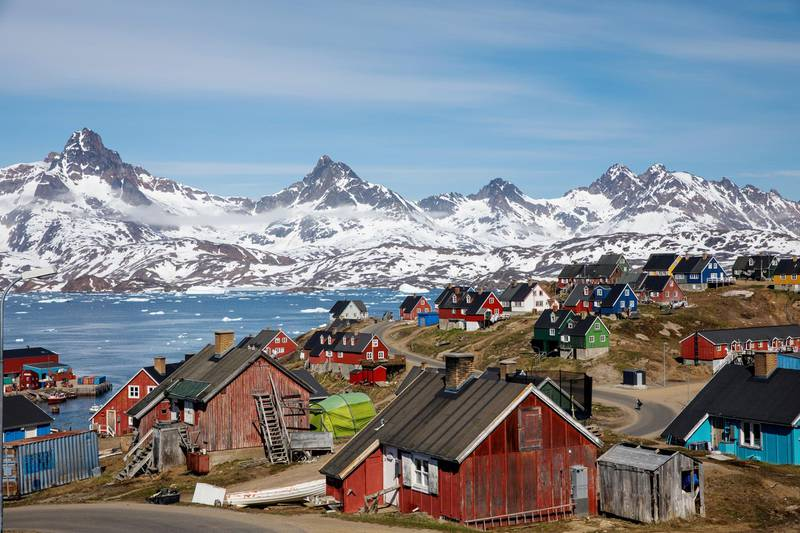 FILE PHOTO: Snow covered mountains rise above the harbour and town of Tasiilaq, Greenland, June 15, 2018. REUTERS/Lucas Jackson/File Photo