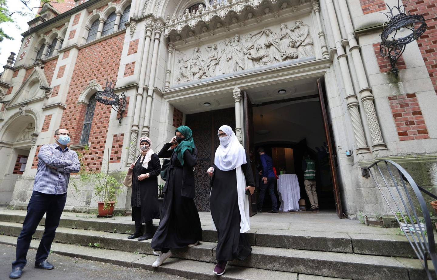 Muslims leave the evangelical church of St. Martha's parish, after their Friday prayers, as the community mosque can't fit everybody in due to social distancing rules, amid the coronavirus disease (COVID-19) outbreak in Berlin, Germany, May 22, 2020.   REUTERS/Fabrizio Bensch
