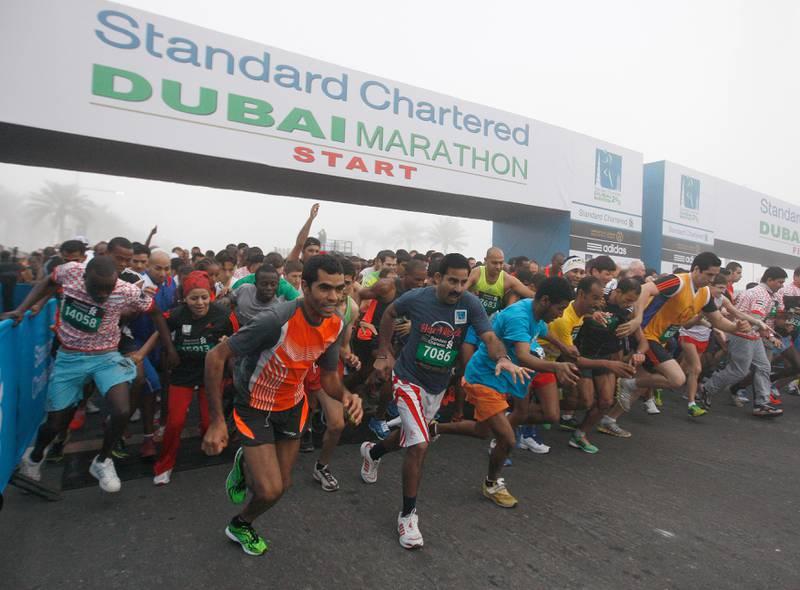 Dubai, United Arab Emirates, Jan 25 2013, 2013 Standard Chartered Dubai Marathon, 10K Run- Runners in the 10K run sprint off the starting line in the Standard Chartered Dubai Marathon, Jan 25, 2013.  Mike Young / The National