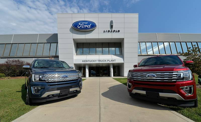 In this Friday, Oct. 27, 2017, photo, vehicles line the entrance to the Ford Kentucky Truck Plant in Louisville, Ky. Ford Motor Co. reports earnings, Wednesday, Jan. 24, 2018. (AP Photo/Timothy D. Easley)