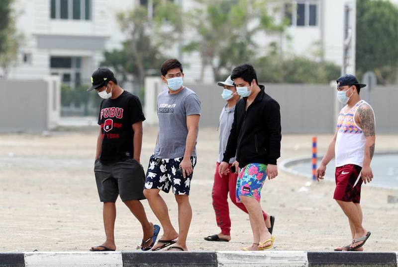 Dubai, United Arab Emirates - Reporter: N/A: People walk through Al Barsha with face masks. Monday, March 30th, 2020. Dubai. Chris Whiteoak / The National