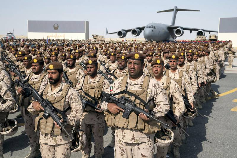 SWEIHAN, ABU DHABI, UNITED ARAB EMIRATES - February 09, 2020: Military personnel participate in a reception at Zayed Military City to celebrate and honor members of the UAE Armed Forces who served in the Arab coalition in Yemen. ( Ryan Carter / Ministry of Presidential Affairs ) ---