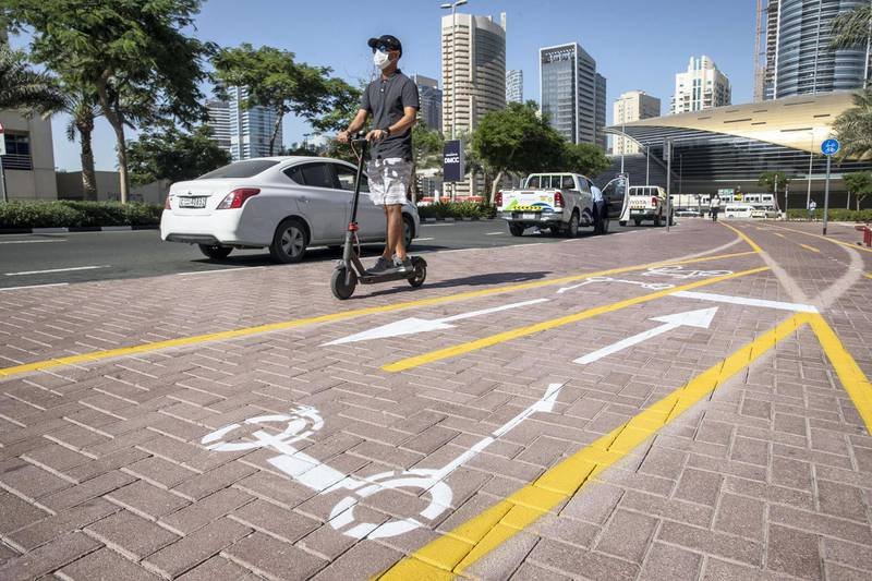 DUBAI, UNITED ARAB EMIRATES. 26 OCTOBER 2020. E-scooter trials rolled out in five areas across city for a year long project for commuters to rent and use e-scooters while commuting to and from tram and metro stations. Special cycle and scooter lanes in JLT next to Al Mas tower. (Photo: Antonie Robertson/The National) Journalist: Kelly Clarke. Section: National.