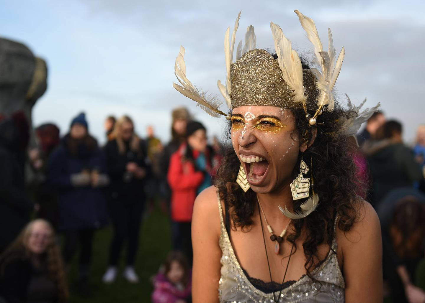 A woman celebrates after the winter solstice at Stonehenge, England, Dec. 22, 2018. Stonehenge, a United Nations Educational, Scientific and Cultural Organization World Heritage site, has been a place of worship and celebration during the winter and summer solstices for many generations. (U.S. Air Force photo by Airman 1st Class Madeline Herzog)