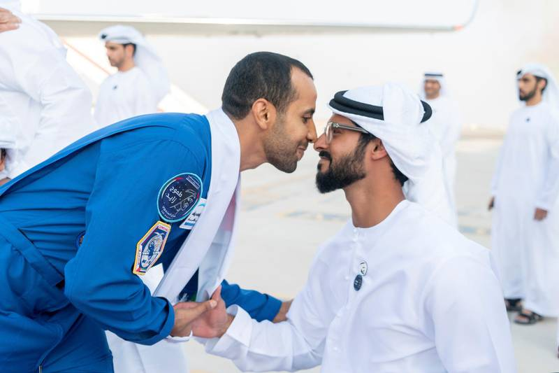 ABU DHABI, UNITED ARAB EMIRATES - October 12, 2019: HH Sheikh Zayed bin Hamdan bin Zayed Al Nahyan (R), receives Hazza Ali Al Mansoori, the first UAE Astronaut to be deployed on a space mission to the International Space Station (ISS) (L), during a home-coming reception at the Presidential Airport.   ( Rashed Al Mansoori / Ministry of Presidential Affairs ) ---