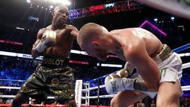 Floyd Mayweather Jr beats Conor McGregor with a 10th-round stoppage to take his record to 50-0