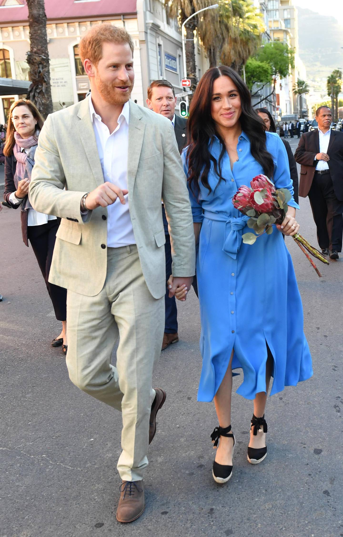 CAPE TOWN, SOUTH AFRICA - SEPTEMBER 23: Meghan, Duchess of Sussex and Prince Harry, Duke of Sussex visit District 6 Museum on September 23, 2019 in Cape Town, South Africa. District 6 is a former inner-city residential area in Cape Town, where freed slaves, artisans, immigrants, merchants and the Cape Malay community lived. For over a hundred years, different communities and races lived side by side, and the District became known for its vibrant culture, music and food. In 1966, the government declared District 6 a whites-only area, and over 60,000 residents were forcibly removed and relocated to the Cape Flats Township. (Photo by Mark Large - Pool/Getty Images)