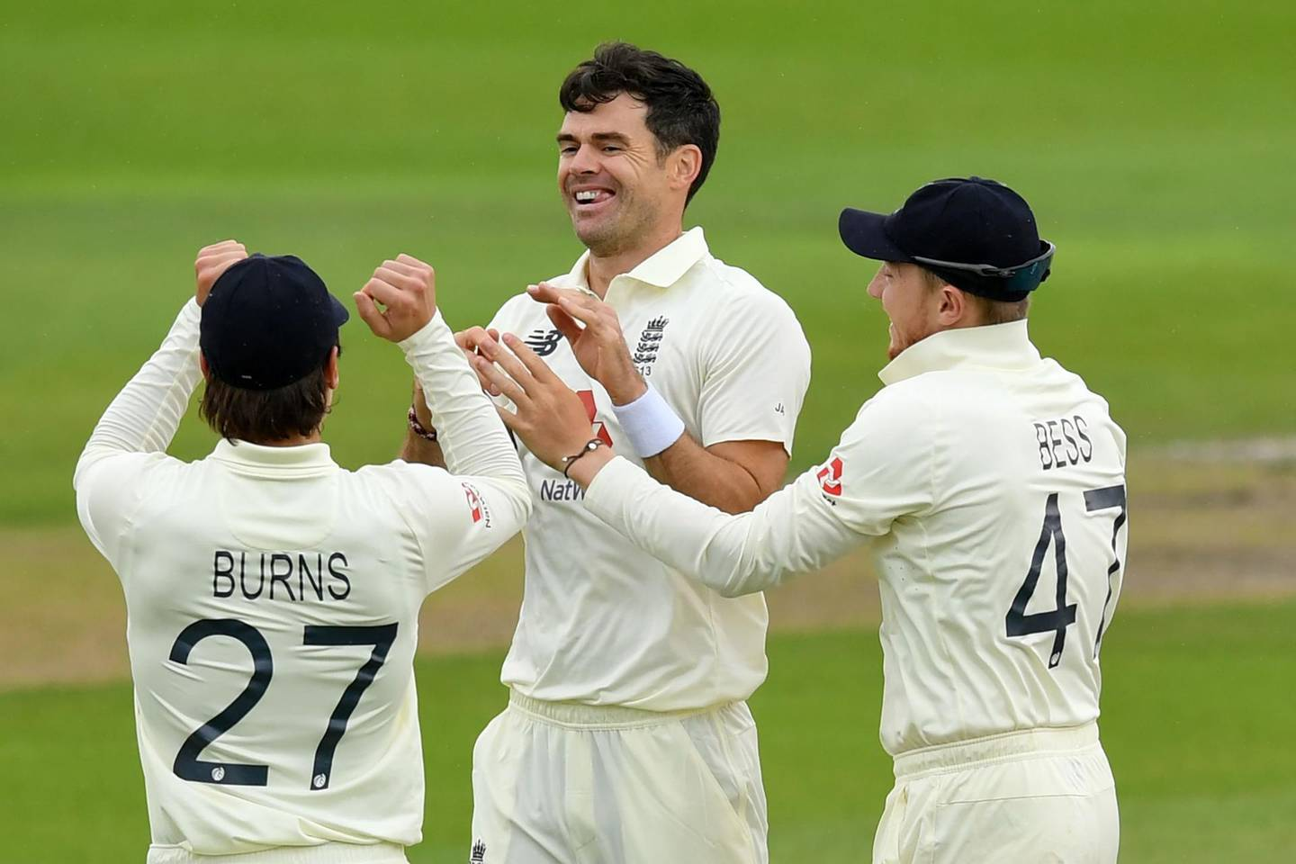 England's James Anderson (C) celebrates with teammates after taking the wicket of Pakistan's Babar Azam for 69 in the opening over on the second day of the first Test cricket match between England and Pakistan at Old Trafford in Manchester, north-west England on August 6, 2020.   - RESTRICTED TO EDITORIAL USE. NO ASSOCIATION WITH DIRECT COMPETITOR OF SPONSOR, PARTNER, OR SUPPLIER OF THE ECB  / AFP / POOL / Dan MULLAN / RESTRICTED TO EDITORIAL USE. NO ASSOCIATION WITH DIRECT COMPETITOR OF SPONSOR, PARTNER, OR SUPPLIER OF THE ECB